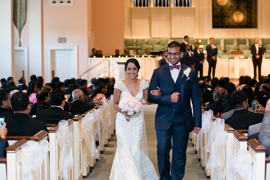 bride and groom ceremony exit by dallas indian wedding photographers