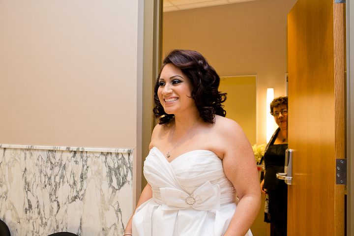 Bride is getting ready to walk down the aisle at her Santa Monica wedding.