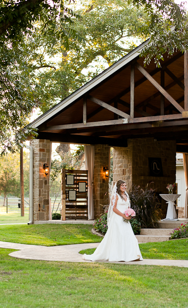 Bride walking down the aisle during her outdoor ceremony at The Orchard.