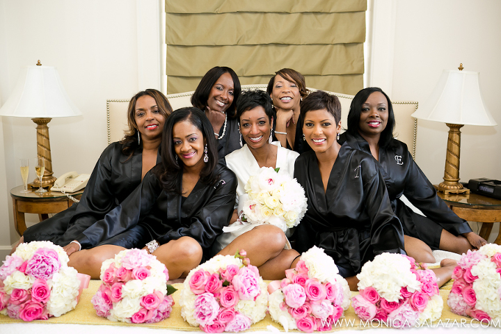 Bride and bridesmaids pose for a cute photo at the Ashton Hotel by Fort Worth wedding photographer
